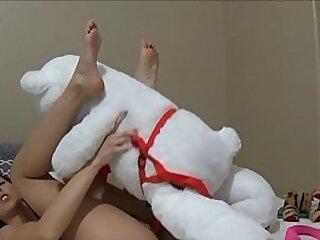 Teen girl fucks teddybear
